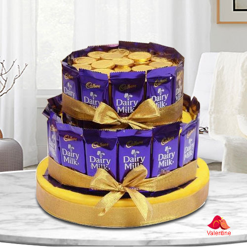 Exceptional Tower Arrangement of Cadbury Dairy Milk with Gold Coin Chocolates
