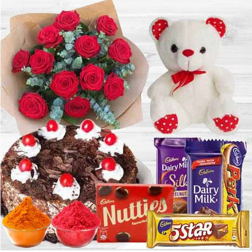 Awesome bouquet of  Roses with a delicious Cake, mixed Cadburys Chocolate and lovely Teddy Bear