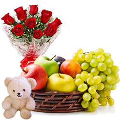 Marvelous Teddy with Roses Arrangement and Fruits Basket