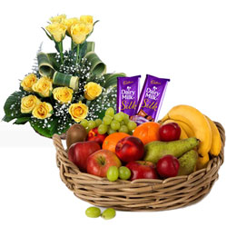 Classic Gift of Mixed Fruits Basket with Cadbury Chocolates and Roses Arrangement