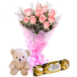 Midnight Gift of Teddy with sweet Chocolates and Roses Bouquet