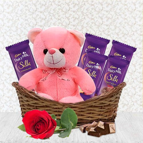 Wholesome Pack of Rose, Teddy N Chocolates in a Basket