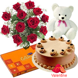 MidNight Delivery ::12 Exclusive  Dutch Red  Roses  Bouquet with Cake , Cadburys Assorted Chocolates and  a Cute Teddy Bear