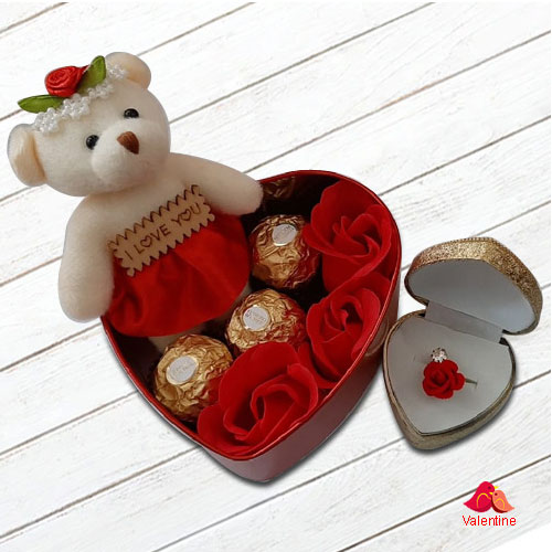 Impressive Gift of Teddy, Roses, Ferrero Rocher Chocolates n a Fancy Ring in a Heart Shape Box
