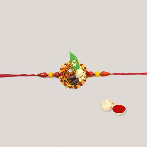 Admirable Beaded Thread Rakhi with Ethnic Design